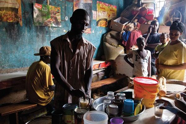 A coffee vendor at Marche Kermel, in Dakar