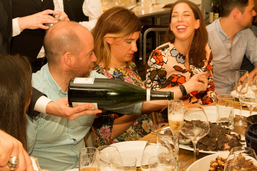 The Door's Jesse Gerstein, writer Kate Donnelly, and Buzzfeed's Erin Phraner enjoy one of Atherton's many courses.