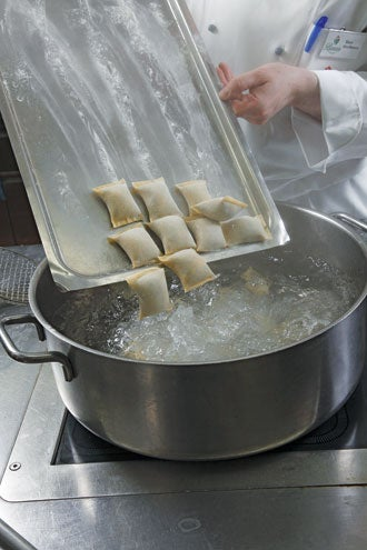 plunging dumplings into boiling salted water