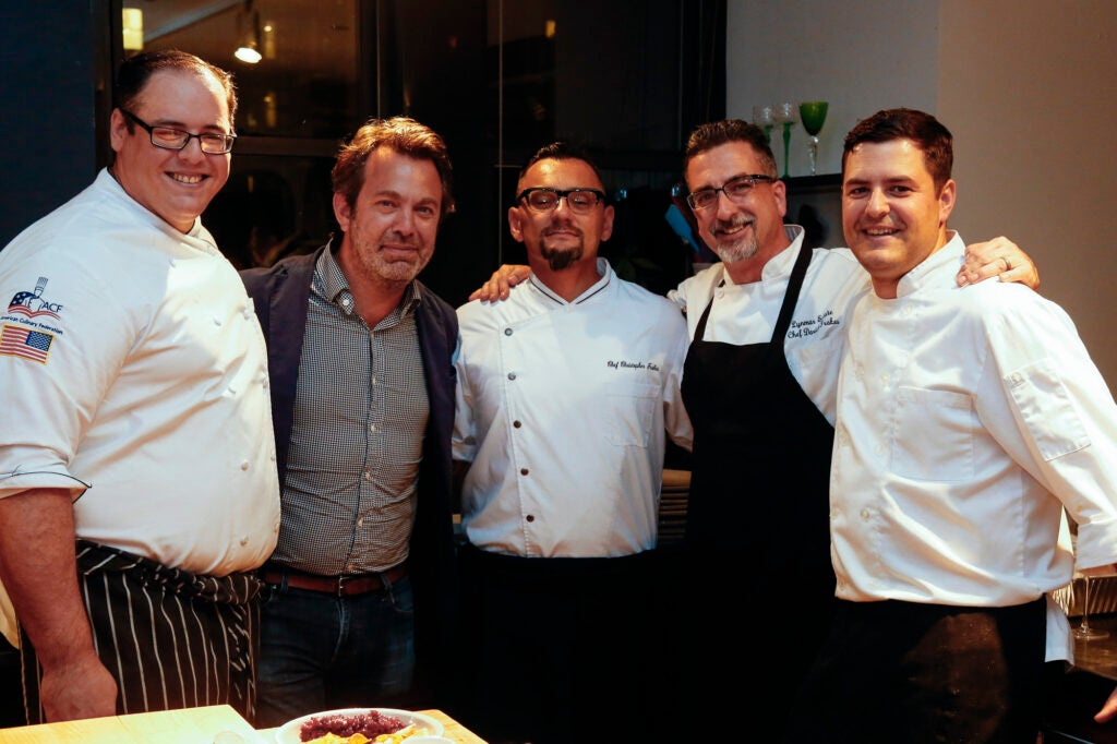 Editor-in-Chief Adam Sachs with the Lynmar Estate kitchen team.