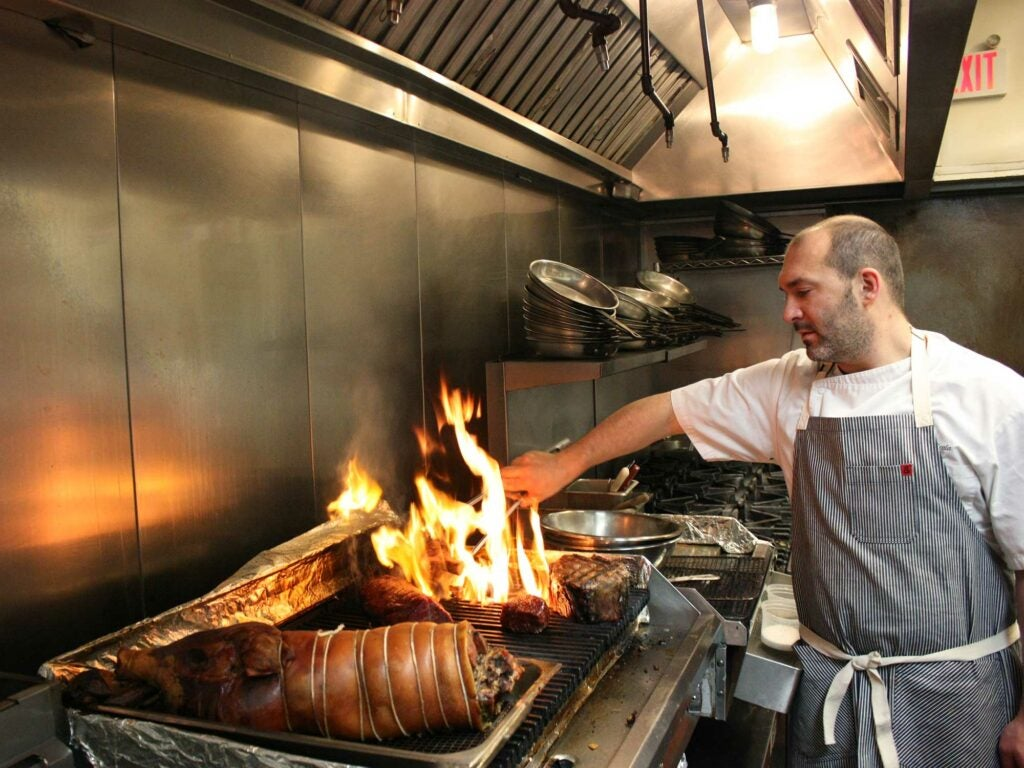 Chef Joe Cicala working just a few of the feast's meat courses