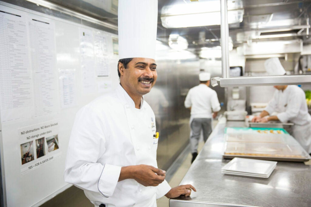 Chef Raj cooks beside his team every day