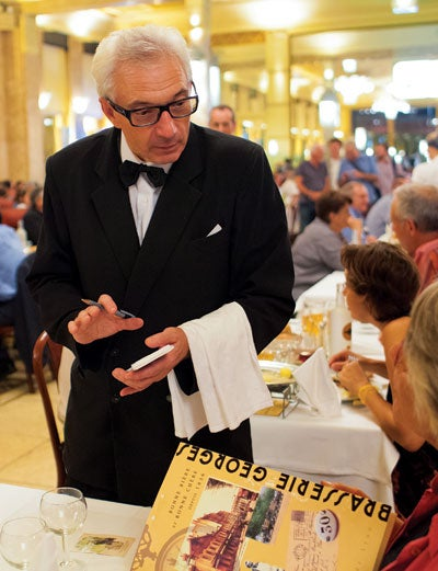 Eric Denis has been a waiter at Brasserie Georges in Lyon for the past 39 years