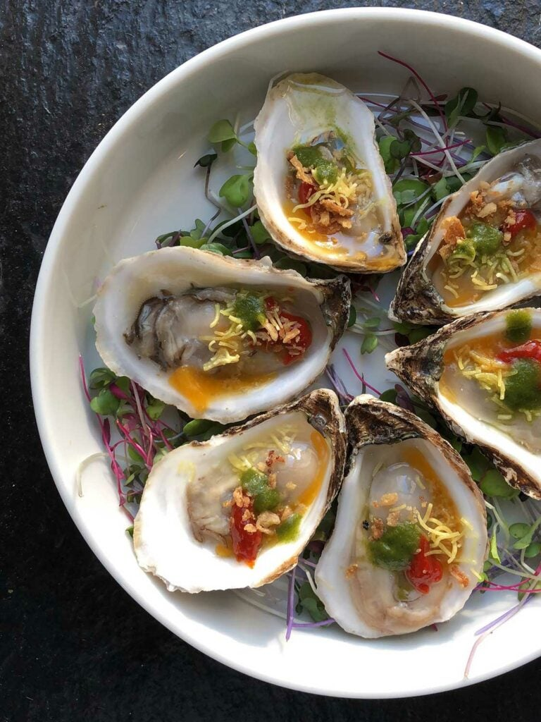 These raw oysters were topped with pickled green mango and sweet-pickled chile.