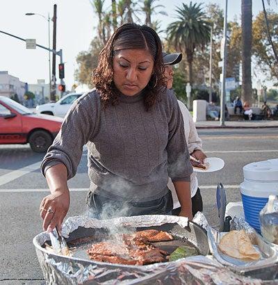 A street vendor preparing carne asada in MacArthur Park