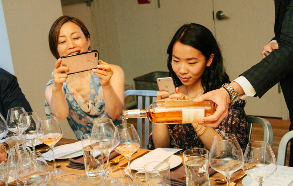 Hannah Lee of Hannah Lee Communications and Jenny Huang of Hello My Dumpling snap photos before the supper.