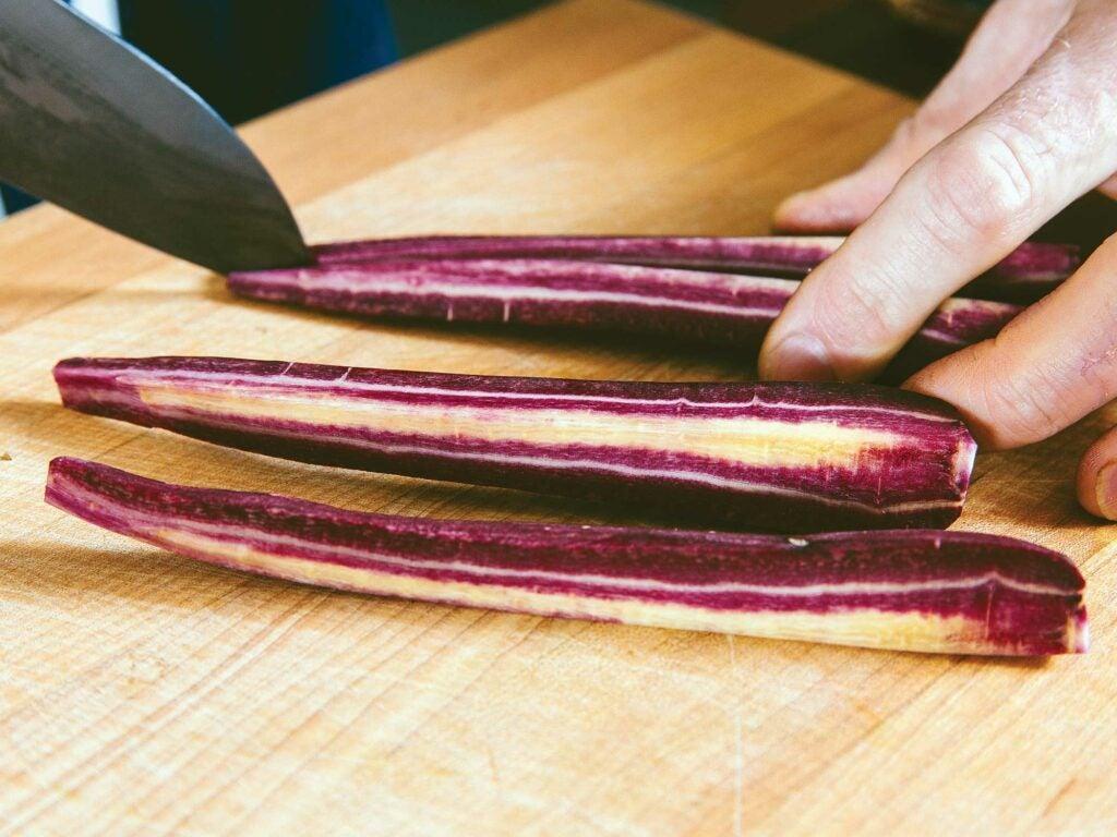 slicing purple carrots