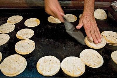 Grilling tortillas in East LA