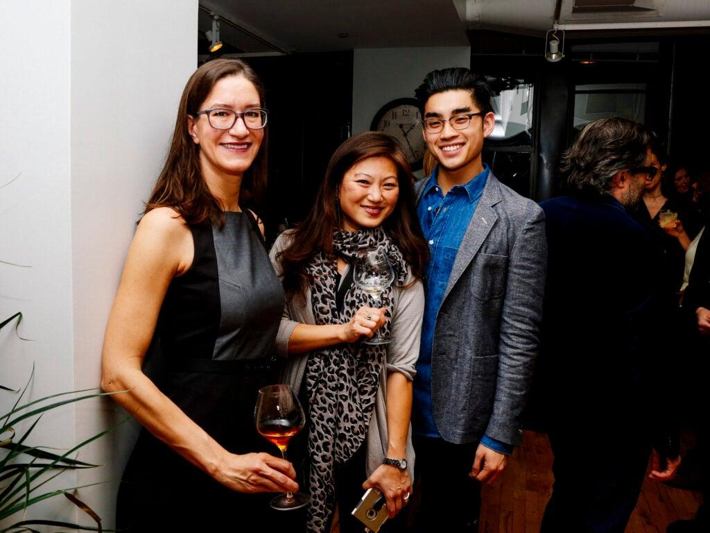 Writer Kathryn Maier, influencer Jean Lee, and SAVEUR Deputy Digital Editor Dan Q. Dao raise a glass to Chef Katie Button.