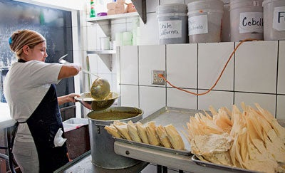 A cook at Tamales Lilianas.