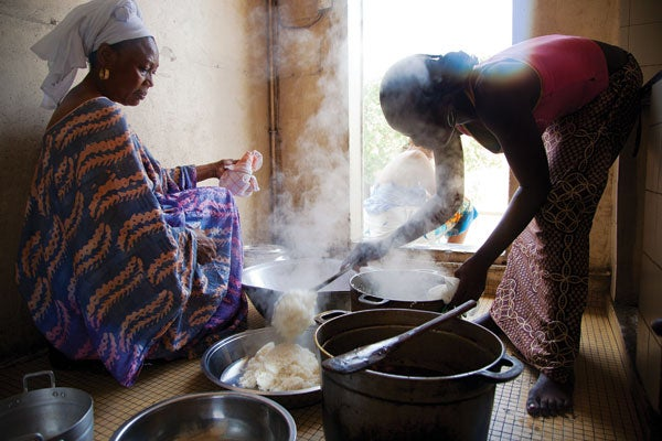 Khady Mbow (left) and her niece Sini prepare a meal at their home in Dakar