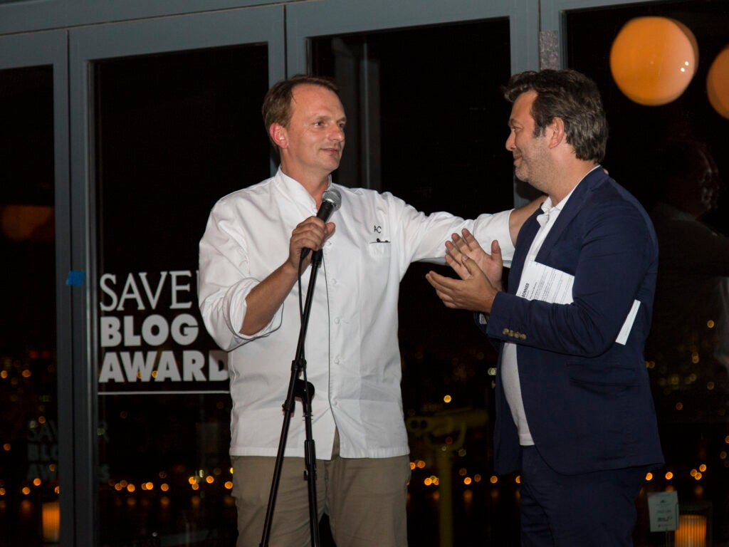Editor in Chief Adam Sachs thanks Chef Andrew Carmelini