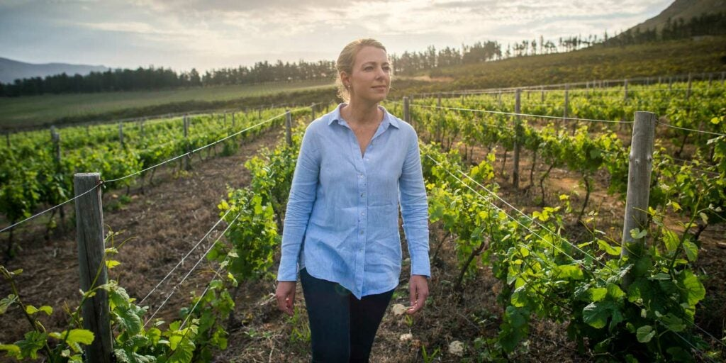 Corlea Fourie checks out her vines.