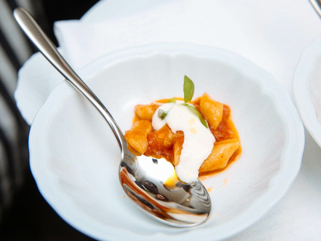 Guests enjoyed passed bites including gnocchetti with tomato sauce at Fusco's opening party.