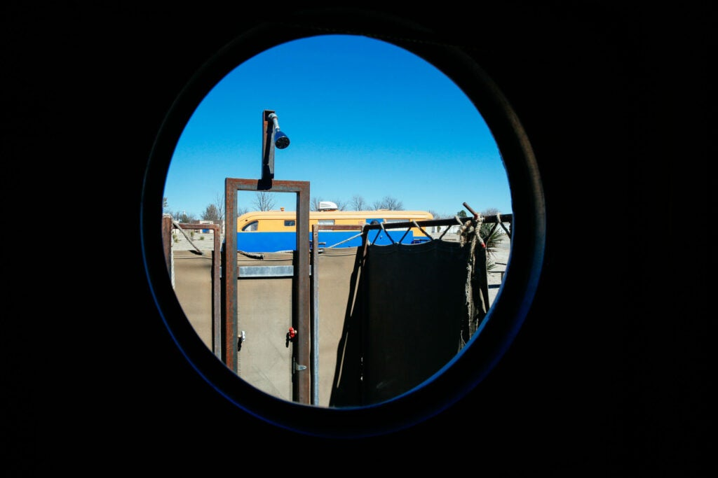 These porthole windows look out to the outdoor shower