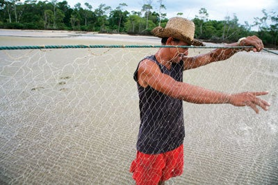 a fisherman checks his nets in the village of Pesqueiro, near Soure.