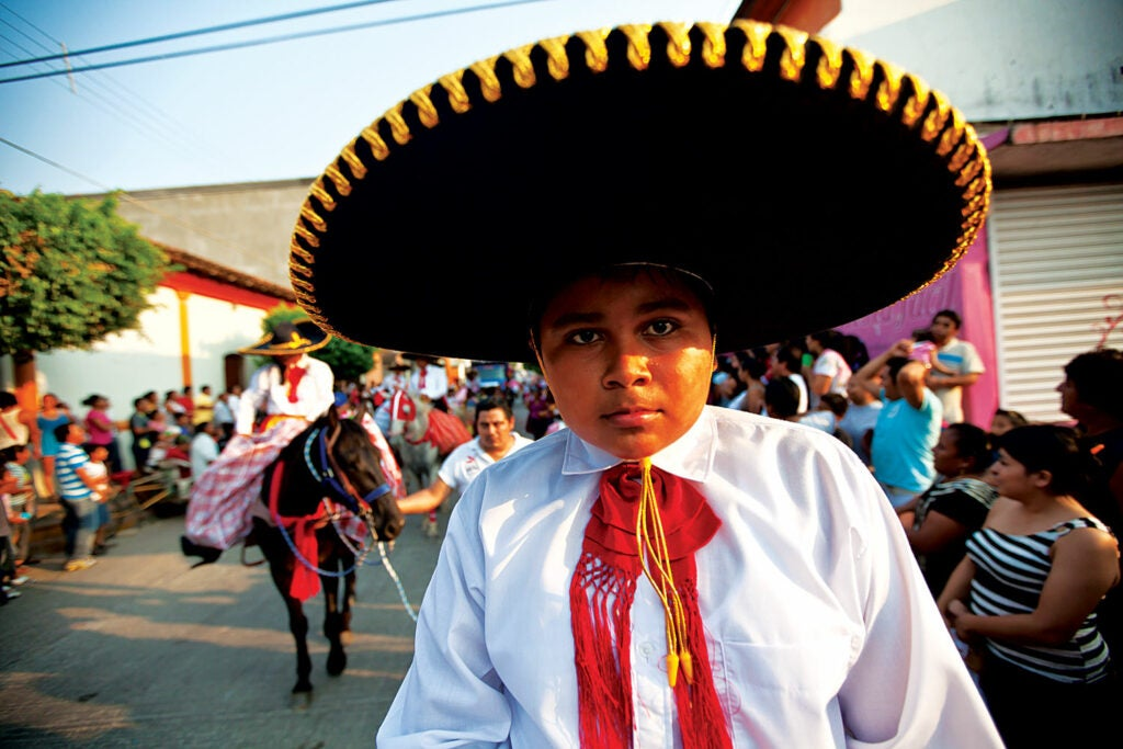 A young participant in a Mexican parade