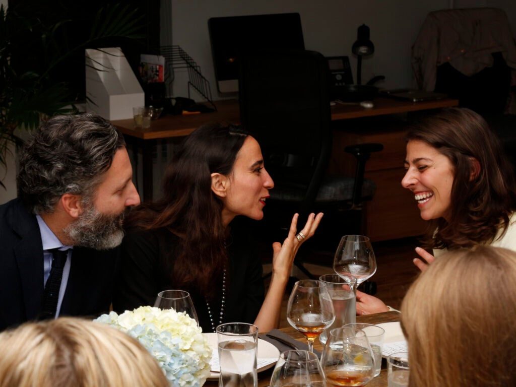Christophe and Nefissa Attard of Air France share a laugh with SAVEUR Test Kitchen Director Stacy Adimando.