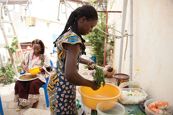 Marie Jeanette Diop (left) and a household employee at Diop's home in Dakar