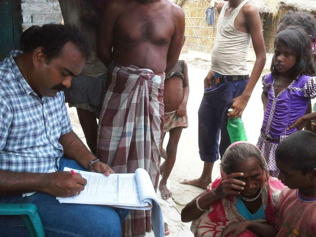 On July 5, 2014, India EIS officer Dr. Somashekar collects data during an investigation of an unexplained acute encephalopathy outbreak affecting young children in Muzaffarpur, Bihar, India.