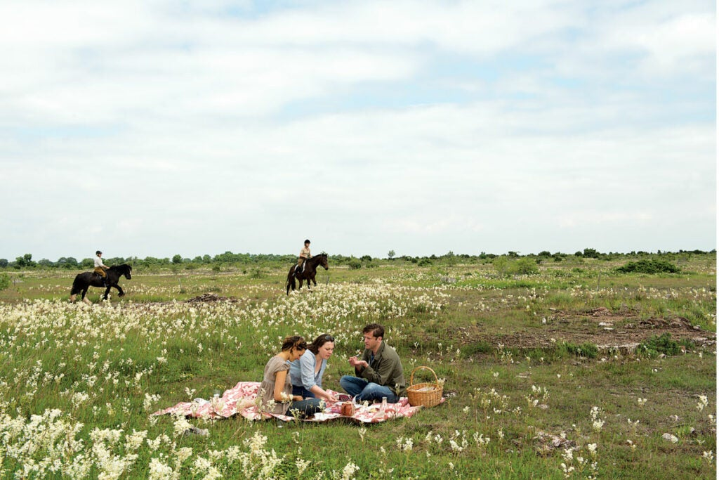 friends picnicking and horseback riding on the Great Alvaret