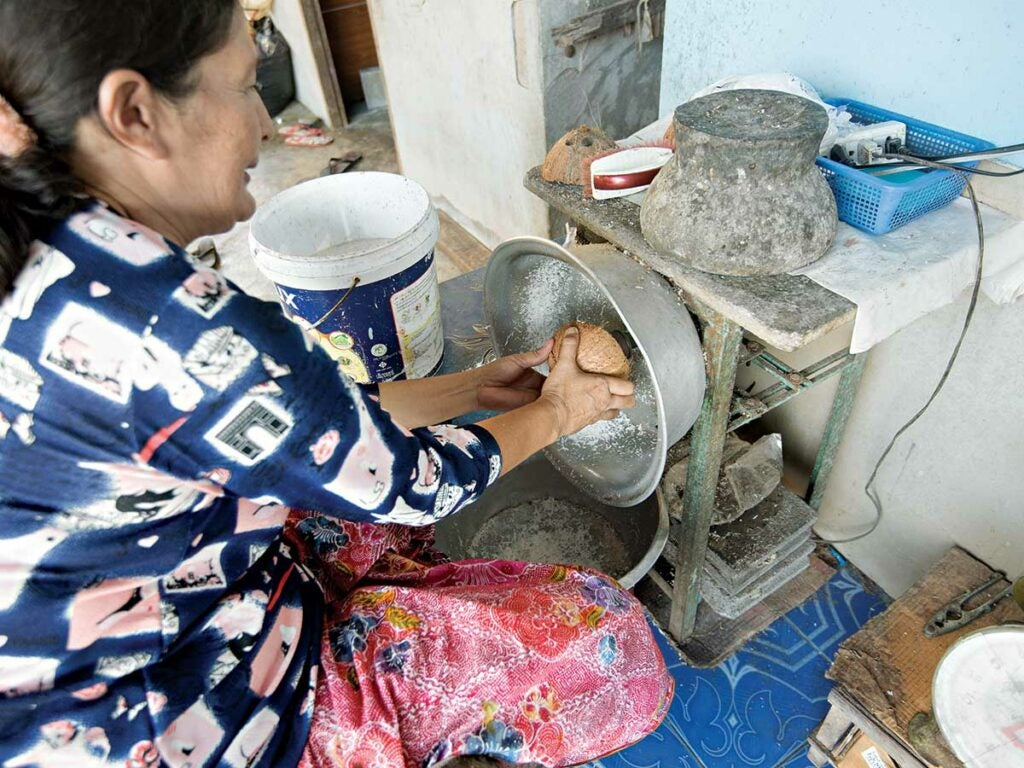 grating coconuts