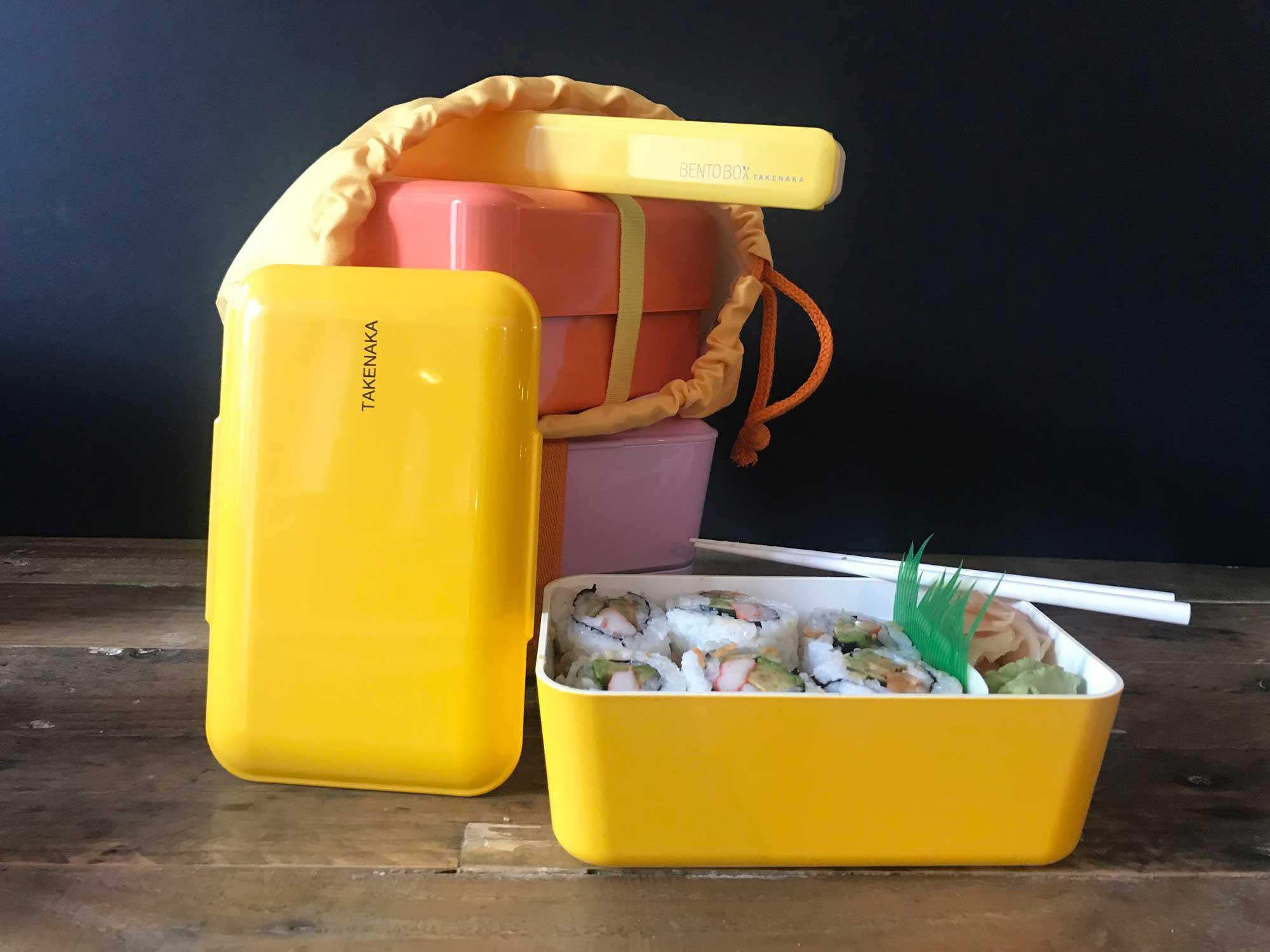 yellow plastic takenaka bento box
