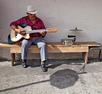 A man playing the guitar in Boyle Heights