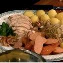 Watch Hunter Lewis Make Turkey with Riesling, Sauerkraut, and Pork Sausages