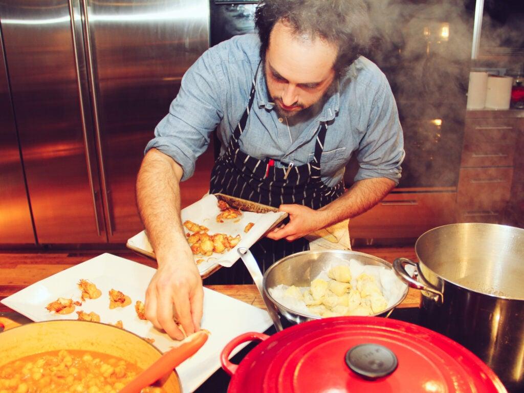 Max Sussman plating crispy artichokes