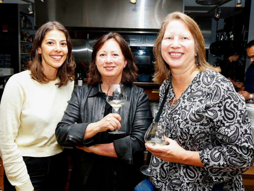 From left, SAVEUR Test Kitchen Director Stacy Adimando, SAVEUR Contributing Editor Shane Mitchell, and writer Kathleen Squires enjoy a drink before dinner.