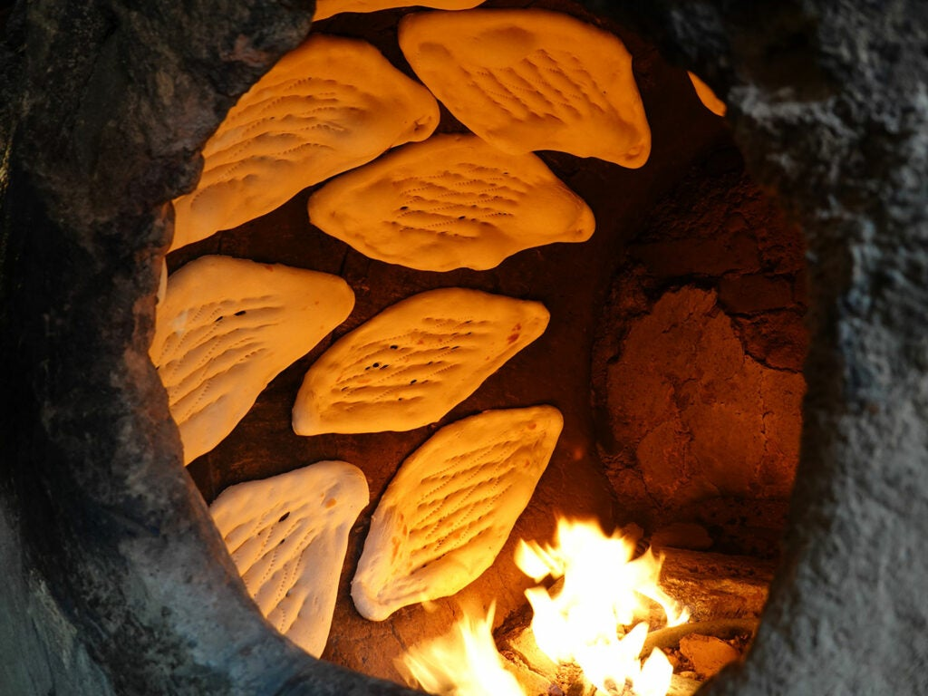 traditional naan in a tandoor