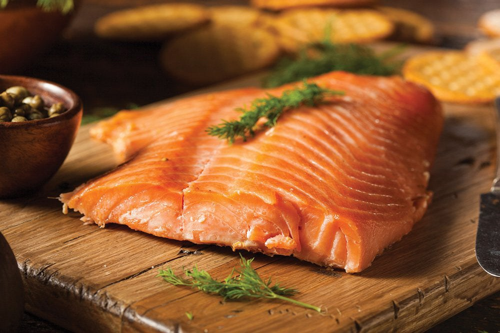 grilled salmon on wooden board