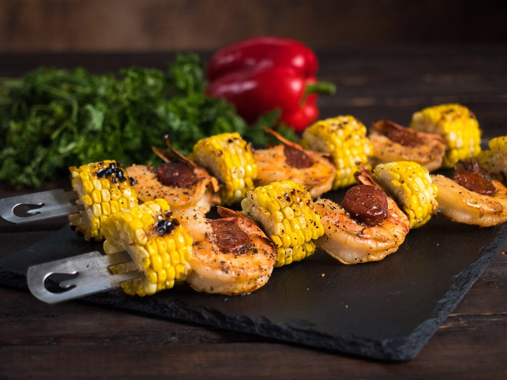 skewers of grilled corn and shrimp