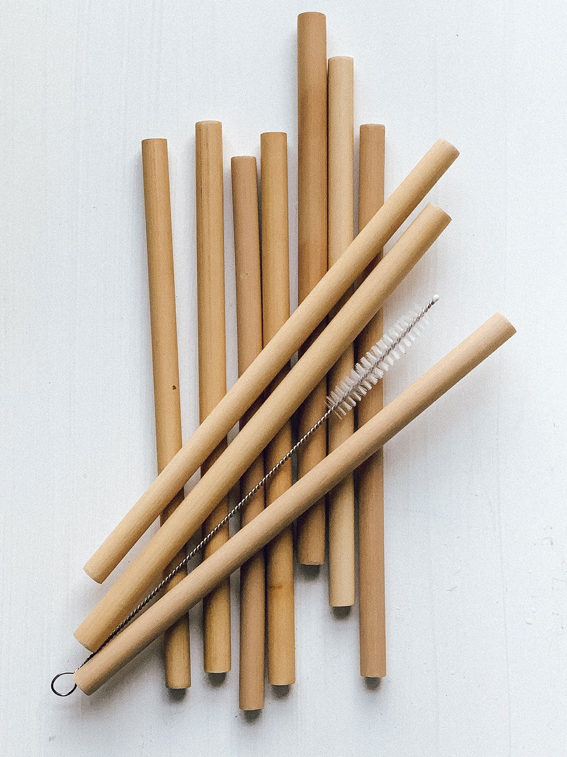 BULUH STRAWS - NATURAL ORGANIC BAMBOO. REUSABLE ECO FRIENDLY AND BPA-FREE. A BIODEGRADABLE SAFE ALTERNATIVE TO PLASTIC, GLASS AND STAINLESS STEEL. 8 STRAWS, CLEANING BRUSH AND CUSTOM BAG