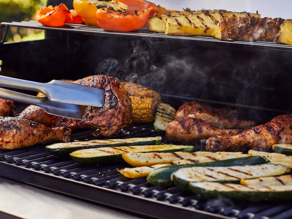strategically placed meat and vegetables on the grill