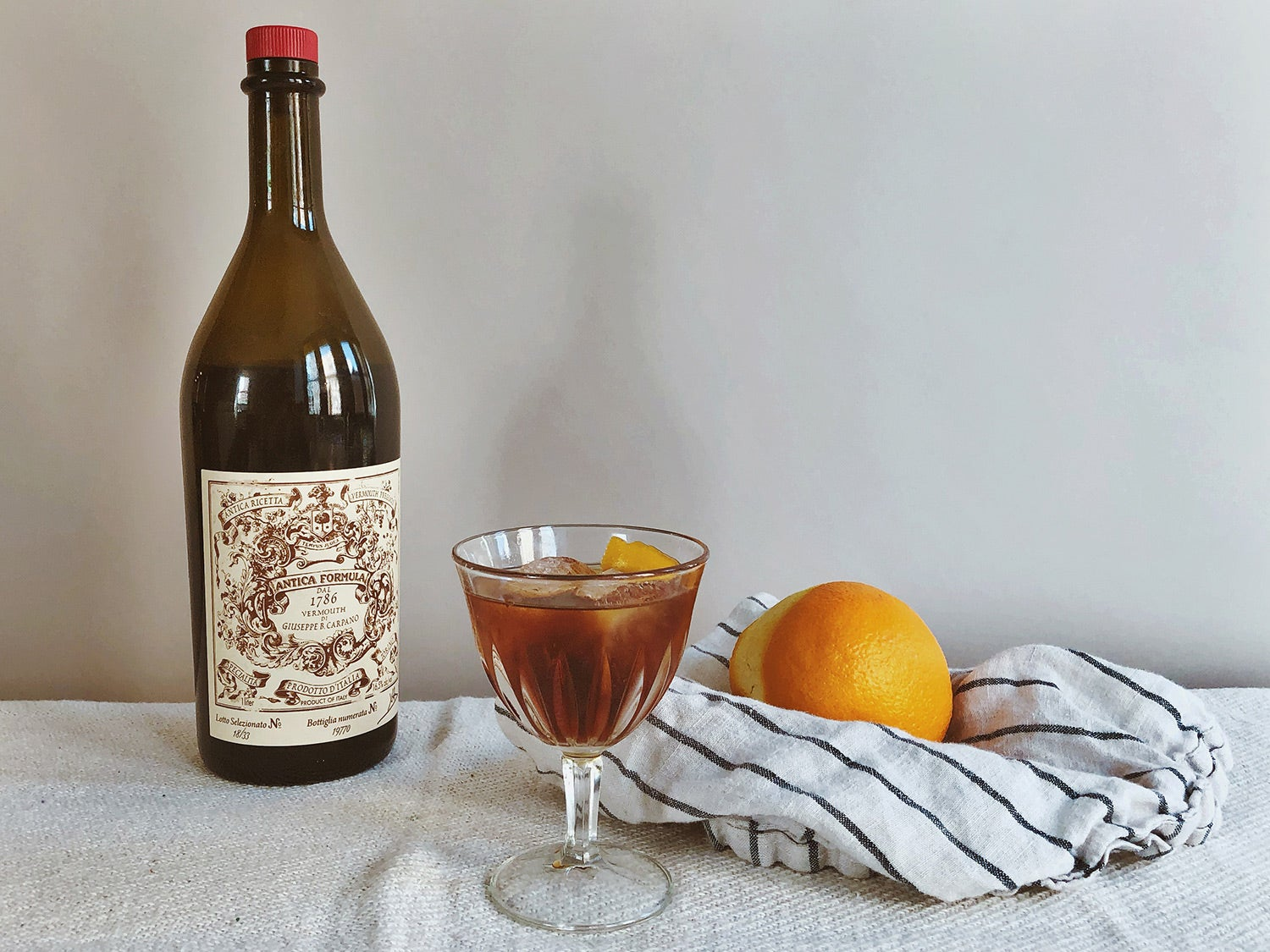 Carpano Antica Formula on the table with fruit