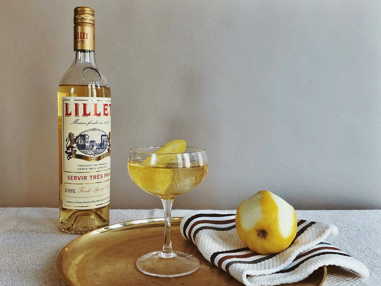 Lillet Vermouth on table with lemon