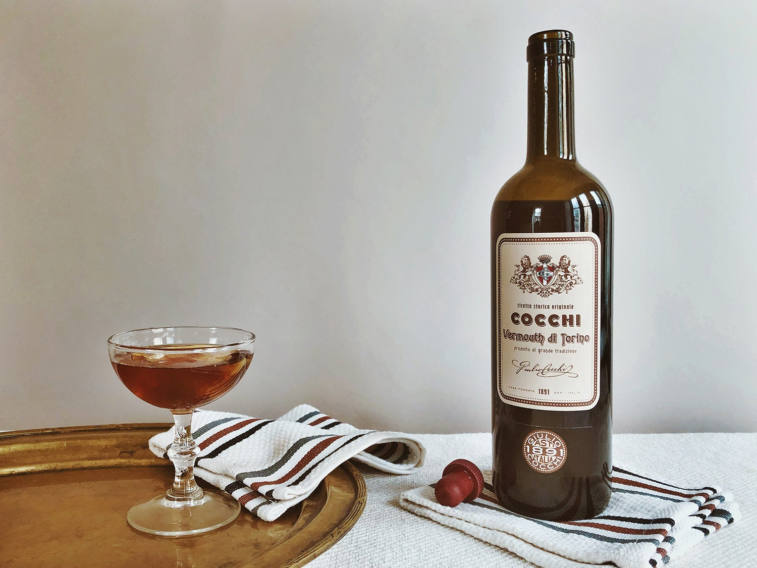 Cocchi Storico Vermouth di Torino on table with towels