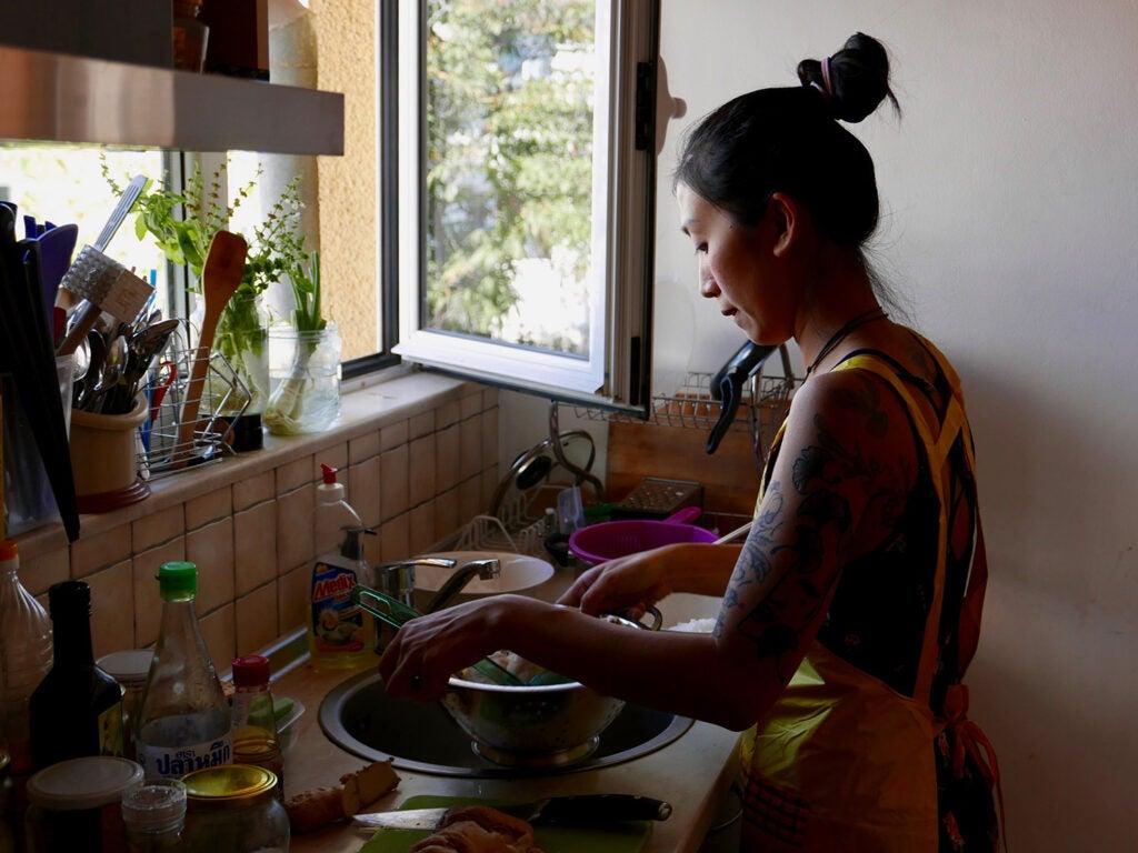 Kim Kim Dao prepping pho in her kitchen