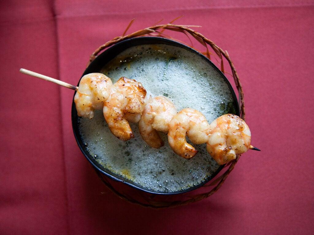 Tacacá with skewered shrimp