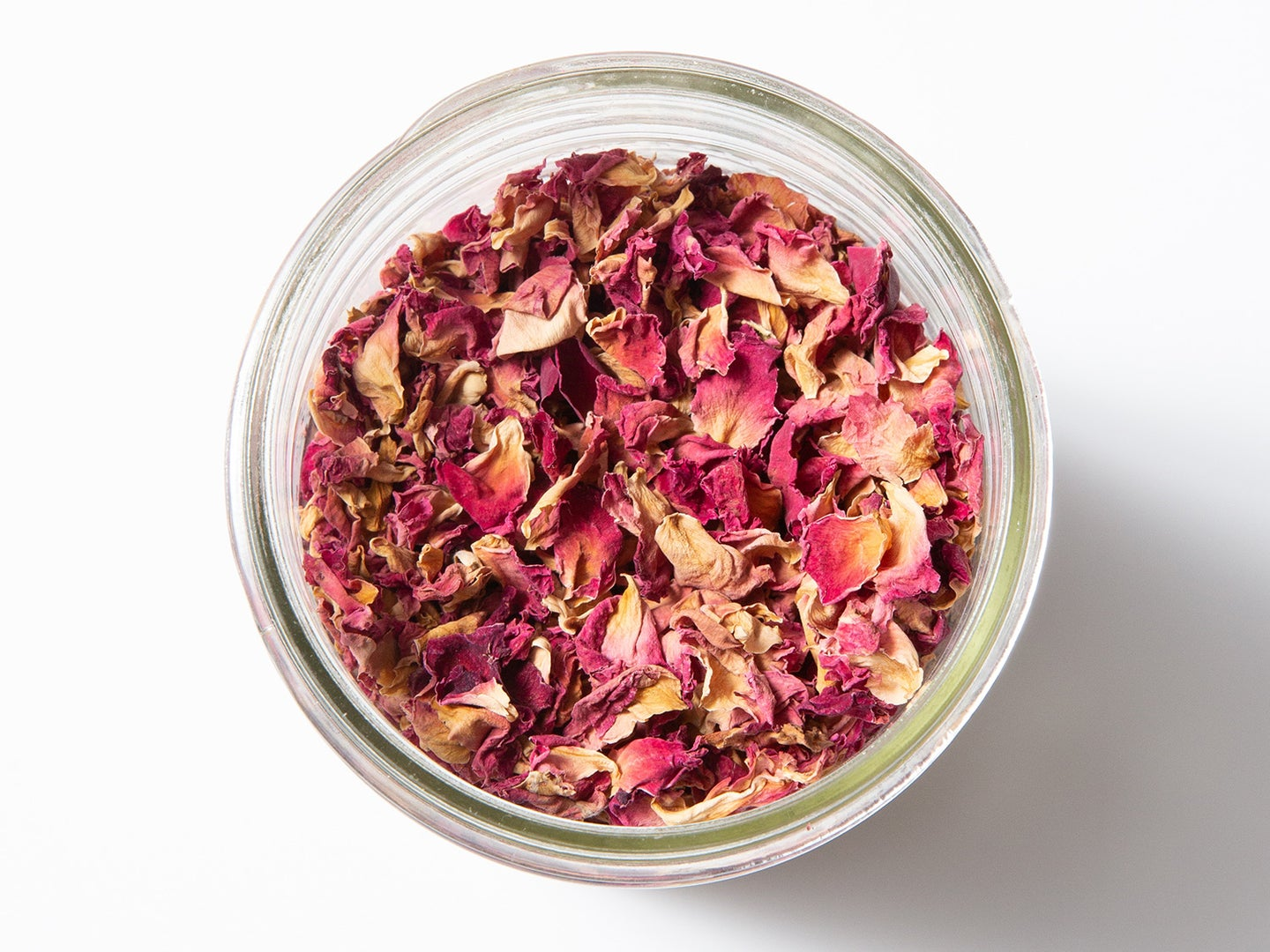 dried rose petals in a glass bowl