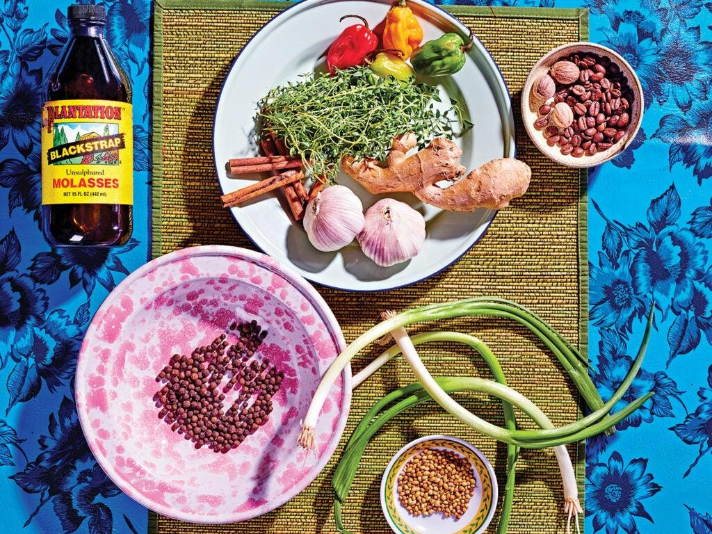 jerk marinade ingredients on a floral blue background