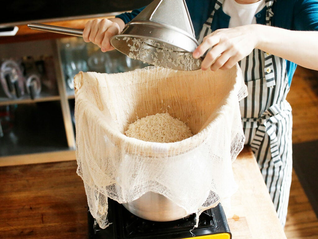 pouring rice into steamer basket