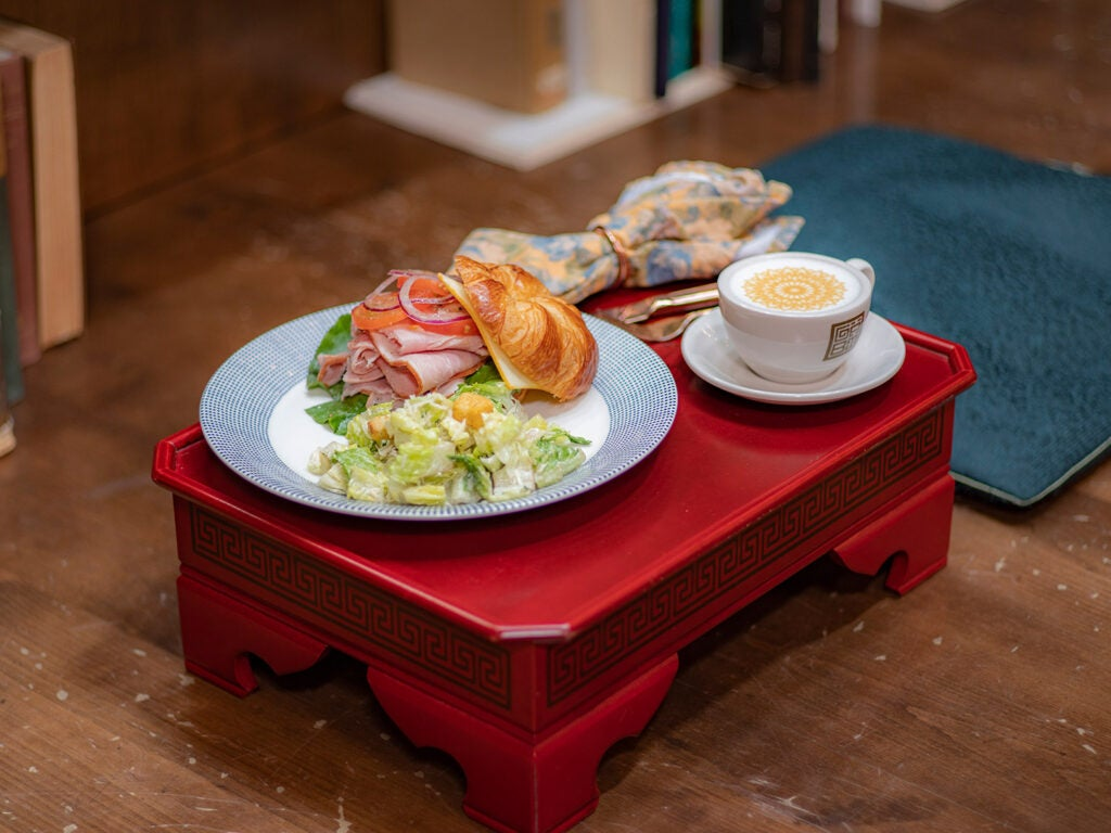 plated sandwich on red stool