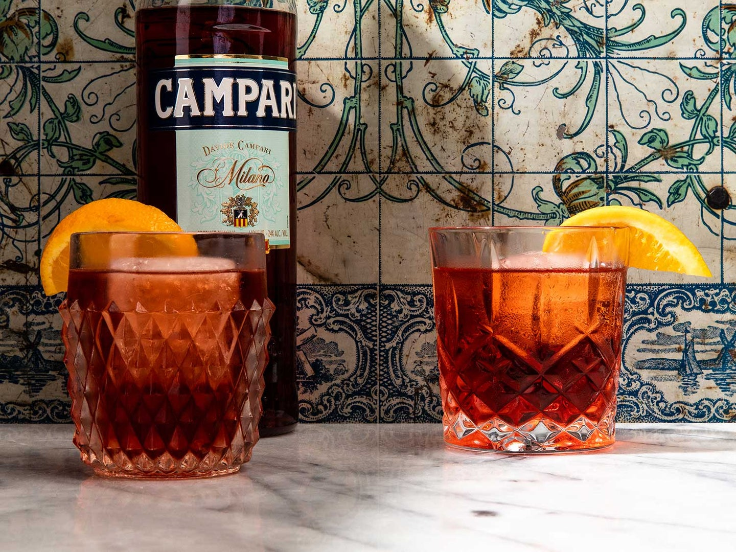 """The Negroni is a bartender's favorite plaything, with ingredients swapped for everything from mezcal to sherry. Try replacing the gin with sparkling wine for a """"bungled Negroni"""", or with bourbon for a Boulevardier. Or call on Aperol instead of Campari and sub in dry vermouth for a Contessa. Here's how to make a classic Negroni, plus a few more of our favorite riffs on the beloved drink."""
