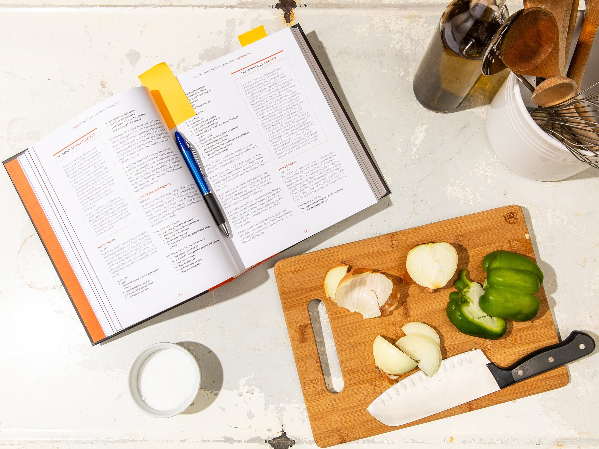 open cookbook with veggies on the cutting board