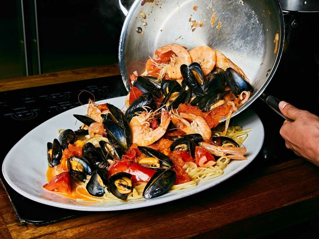 Seafood Pasta with Tomatoes, Chiles, and Mint served on platter.
