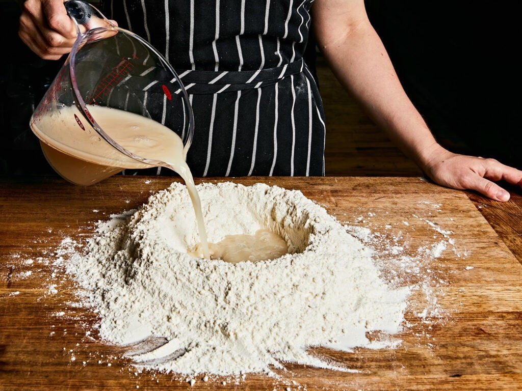 Well of flour for making pizza dough.