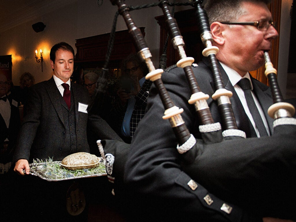 """A heaping haggis is presented on a silver platter at one of Scotland's annual """"Burns' Suppers"""" to celebrate the poet Robert Burns."""